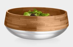 A luxurious bamboo bowl with with mirror-polished stainless steel on the exterior, Great for serving up salads or displaying fruits and more in style.