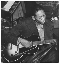 """Charles Henry """"Charlie"""" Christian was an American swing and jazz guitarist. Christian was an important early performer on the electric guitar, and a key figure in the development of bebop and cool jazz. Jazz Artists, Jazz Musicians, Music Artists, Louis Armstrong, Jazz Cat, Cool Jazz, Jazz Guitar, Jazz Blues, Music People"""