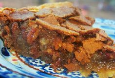 My Favorite Pecan Pie EVER - It's not made with any corn syrup, just butter - giving it a rich, addictive flavor. You won't be able to go back to your normal pecan pie recipe after having this!