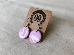 FREE SHIPPING! A beautiful set of hand made, unique polymer clay hook drop earrings. They measure approximately 20mm in diameter. The lovely marble effect of pink and white makes these one of a kind, perfect for any gift. Surgical stainless steel hooks mean these are safe for sensitive ears! Handmade Jewellery, Earrings Handmade, Unique Jewelry, Handmade Gifts, Sensitive Ears, Polymer Clay Projects, Pink White, Hooks, Marble