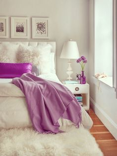 feminine bedroom with purple accents, cream colored bedroom, white sheepskin, sherwin williams mature grape