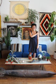 Living Room Wall: Wood Shelves, Textiles, Plants, Art and Photography.