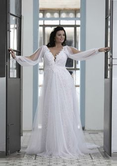 This long sleeve wedding dress has been one of the more popular styles in the Darius Cordell bridal collection for plus size brides.