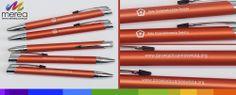 Pomarańczowe, metalowe długopisy z grawerem dwustronnym