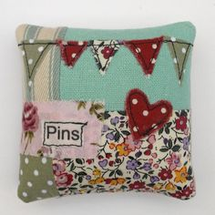 Pin Cushion - love the bunting and hearts applique