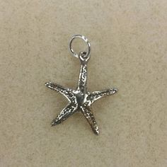 NEW Sterling Silver Starfish Charm Brand New Sterling Silver Starfish Charm Add this a necklace or a bracelet to make it your own!  Price is Firm!  Add Additional Charms to a bundle and save on shipping! Accessories