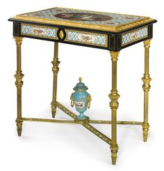 A FINE LOUIS XVI STYLE GILT-BRONZE MOUNTED SÈVRES STYLE CERAMIC DECORATED DRESSING TABLE PARIS, LATE 19TH CENTURY the hinged top inlaid with kingwood veneers and a mirror plate to its reverse, opening to reveal a compartmented interior inlaid with burl wood