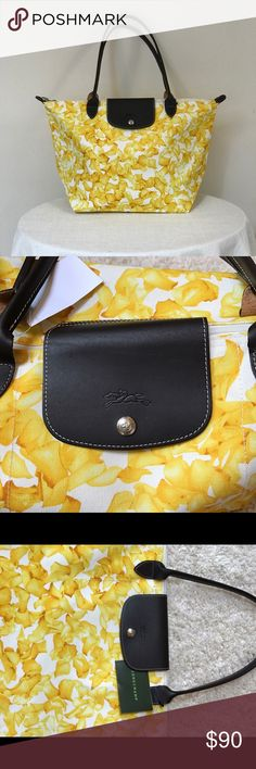 Longchamp Darshan floral tote NWT Spring starts today with this Longchamp Darshan floral canvas tote in cheerful yellow and ivory  hues. NWT.  Lightweight yet very sturdy. One snap closure.  Size: 19 inches by 13 inches. Almost 8 inches deep. Straps have 9 inch drop. Guaranteed authentic. Longchamp Bags Totes