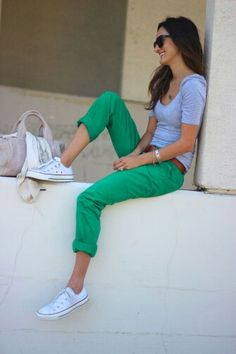 green jeans, gray top, sneakers