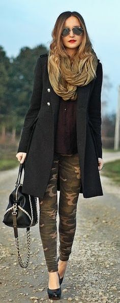 Burgundy top, black coat + camouflage pants