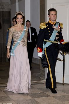 Beautiful: The crown princess attended a dinner at Christiansborg Palace with her husband, Prince Frederik, in a soft pink embellished gown and tiara