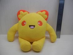 Get your very own Banna Spriteling Plush  Meet one of the many little monsters of the Spriteling Army! This adorable yellow monster toy is an original creation and the perfect addition to your Japanese themed stuffed animal collection!  This yellow kawaii monster is approximately 8 inches tal...