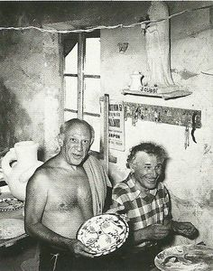 Old Friends: Artists, Pablo Picasso & Marc Chagall, laughing together in a studio space.