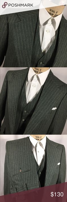 Vintage 3 Piece Suit Green Pinstripe Chalkstripe This is a 70's 3pc wool suit. HAS NEVER BEEN WORN. I removed original paper tags. GORGEOUS in rich smoky green w/ soft butterscotch chalk stripe. Boardwalk empire meets Tom Ford. Stunning one of kind with unfinished leg hem (like new). Unique, vintage and not pre-worn. One micro hole near cuff. Keep in mind the dress form in the photos is undersized so the suit is more FITTED. The only thing you need to do to this suit is taper the lower legs…