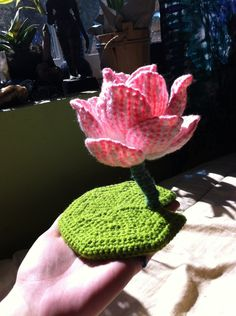 My brother commissioned a pink lotus and gave me free reign over the design so I came up with this. The petals are white with embroidered pink sewn onto a yellow core. Wire stem and base with a dis...