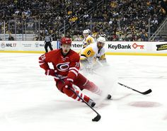 Sebastian Aho Photos Photos - Sebastian Aho #20 of the Carolina Hurricanes skates with the puck against the Pittsburgh Penguins at PPG PAINTS Arena on December 28, 2016 in Pittsburgh, Pennsylvania. - Carolina Hurricanes v Pittsburgh Penguins