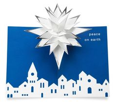 Google Image Result for http://christmascards3d.com/wp-content/uploads/2011/11/Amazon.com-Moma-Holiday-Robert-Sabuda-Pop-up-Cards-Village-Star-MAIN.jpg