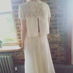Two piece wedding dress. Open back, flower appliqué, lovingly redesigned from a 1960's original wedding dress.