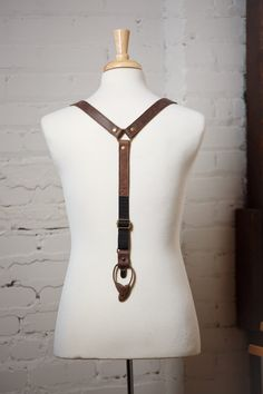 """---These are genuine FULL GRAIN LEATHER suspenders HANDMADE IN US ---    **This is MADE TO ORDER. Please allow 5 - 7 days for production. If you need this item sooner, please contact me directly.    These unique and eye-catching leather suspenders and bow ties are handcrafted in New Orleans with high quality leather.    Suspender details:    • 1"""" wide double sided straps   • Adjustable straps  • Antique brass clips  • Neatly packaged in a cotton bag with tags (Perfect as a gift!)  • Matching…"""