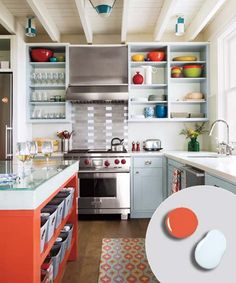 kitchen with light blue gray painted open kitchen shelving cabinets and bright orange painted island