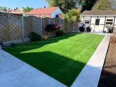 A lovely green artificial lawn set within a white pathway. Just one of many installations by Trulawn and using our own exclusive, high quality grass.