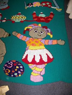 Upsy Daisy cross stitched onto a crocheted blanket