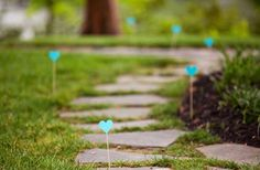 wedding path markers: not silly little hearts though...use blue/green on these short scewers between the larger arrow type signs. Maybe make them favor-ish.