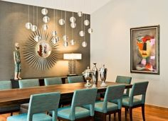 Dining room designed by Eminent Interiors. The abstract painting adds another layer of interest to the room.