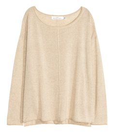 Fine-knit sweater in a slightly sheer cotton blend with a slightly wider neckline. Seam at center front and back, dropped shoulders, long sleeves, and roll edges at neckline, cuffs, and hem.