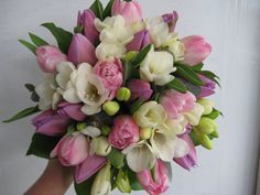 a sweet wedding bouquet of scented white freesias and pink tulips. We love spring!