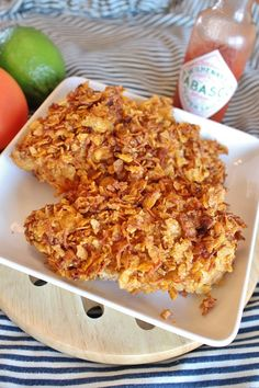 Oven-Fried Mexican Chicken  MARINADE: 1 cup V-8 juice + ¼-1 tsp Tabasco sauce (depending on how spicy you like it); 2½ lb boneless, skinless chicken breasts  COATING: ½ cup shredded cheddar cheese; 3 cups corn flakes, crushed; 1 tsp garlic powder; ½ tsp salt; ½ tsp pepper; ½ tsp chili powder; ½ tsp paprika; ½ tsp oregano; ½ tsp cumin