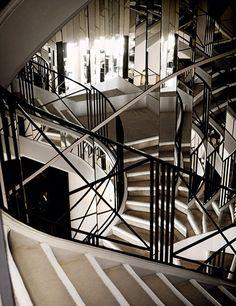 A rare glimpse inside Coco Chanel's private residence. - The staircase to Coco Chanel's private apartment, reflected in mirrors.