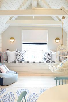 bonus room in attic with angled ceiling and ceiling beams, built in window seat in family room decor or bonus room decor, playroom decor with built in window seat and activity table, lake house decor Attic Design, Playroom Design, Interior Design, Attic Playroom, Playroom Ideas, Attic Loft, Attic Bedroom Designs, Garage Attic, Bonus Room Design
