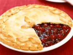 Bake an all-American Cherry Pie recipe from Food Network using fresh or frozen cherries and a buttery pie dough crust for a fruity summer dessert.