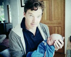 And here is Benedict Cumberbatch holding a baby.  I just spontaneously ovulated.
