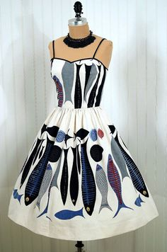Fabulous 50s summer dress-I'm not sure how I feel about wearing a dress that looks like it has a bunch of dead fish on it, but the graphics are good. :)