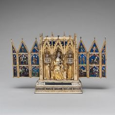 Reliquary Shrine  Attributed to Jean de Touyl   (French, died 1349/50)    Date: second quarter 14th century  Geography: Made in Paris, France  Culture: French  Medium: Gilt-silver, translucent enamel, paint  Dimensions: Overall (open): 10 x 16 x 3 5/8 in. (25.4 x 40.6 x 9.2 cm)  Classification: Enamels-Translucent