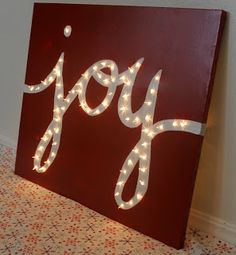 This is really pretty.  I am going to make that.  I think I might hang it up on my wall in the entry.   Make a little notch so the cord can come thru....  From:  http://www.thechildatheartblog.com/2013/11/holiday-joy-light-marquis-canvas.html