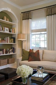 Contrast banding on top of the curtain panel can make an equally bold statement. You also could use decorative trim or beading to connect the two colors.