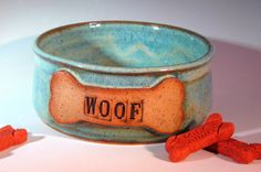 Handmade Pottery Dog Bowl, Ceramic Dog Food Dish, Woof, Blue Stoneware Pet Feeding Bowl. $26.00, via Etsy.