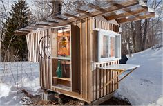 """At about 24 square feet, the Gypsy Junker, made primarily out of shipping pallets, castoff storm windows and a neighbor's discarded kitchen cabinets, is the largest of Mr. Diedricksen's backyard structures."