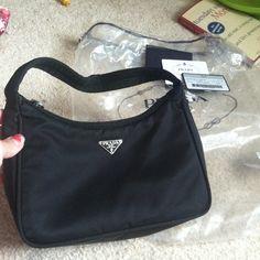 "Selling this ""Excellent cond authentic Prada tessuto sport bag"" in my Poshmark closet! My username is: bogrady0123. #shopmycloset #poshmark #fashion #shopping #style #forsale #Prada #Handbags"