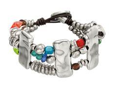 """Pulsera """"Atlantis"""" de Uno de 50, Triple pulsera de cuero unidas por plaquitas de metal bañado en plata, con cuentas plateadas y cristales de colores"""