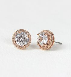 These gorgeous rose gold studs are the perfect earring to achieve the classic bridal look. Also available in SILVER & GOLD - 18K Rose Gold plated - Cubic Zirconia pave crystals - Diameter 0.4 in (1 cm