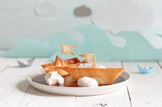 Filo boats with choclate water and whipped rocks