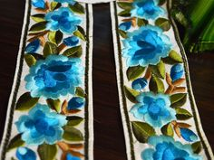 Turquoise, Brown and Green Embroidered designer Roses Lace and Trims, it is 2.5 inches wide.This beautiful Lace can be used for designing stylish blouses, shrugs, skirts, tunics, festive wear,...