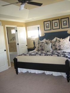 love the black bed and bedding with the yellow walls.separate office space wall color faye