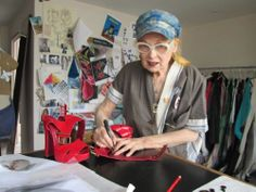 Bid on Vivienne's signed red elevated sandals so the Small Steps Project can help kids on dumps.