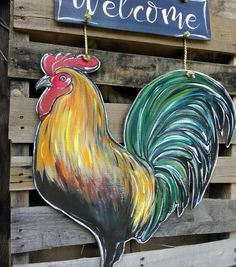 Charming Welcome Rooster door hanger. This boldly painted rooster is sure to catch the any passer bys eye! Custom Door Hangers, Cross Door Hangers, New Crafts, Hobbies And Crafts, Wood Crafts, Painted Boards, Painted Signs, Painting On Wood, Sign Painting