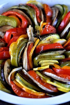 Ratatouille Recipe - So colorful and delicious! Such a beautiful way to eat your veggies! from addapinch.com